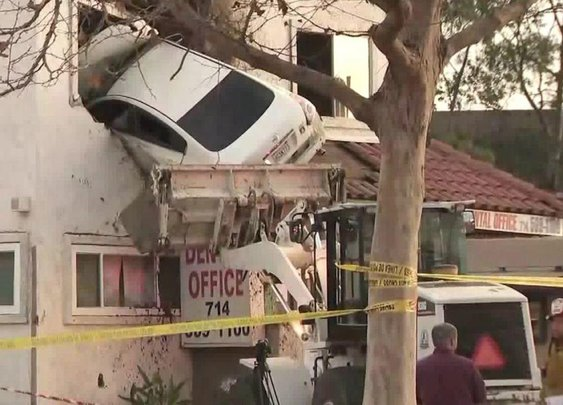 Car goes airborne, crashes into 2nd-floor dental office