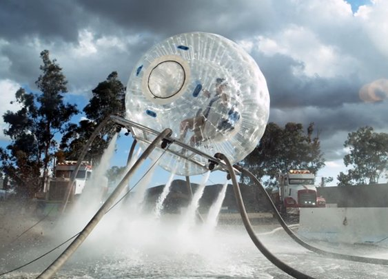 Flying Around in a Giant Inflatable Hamster Ball Equipped With Powerful Water Jets in Slow Motion