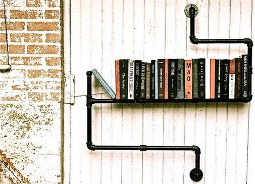 Industrial pipe shelf book holder