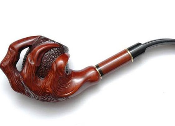 Hand Carved Claw Pipe   inStash