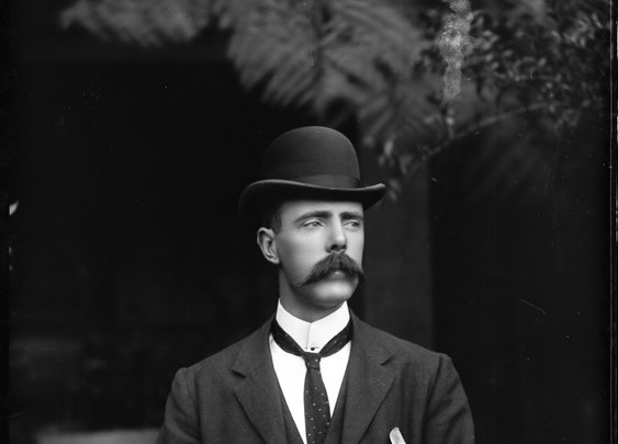 Portrait of a man in suit with waistcoat