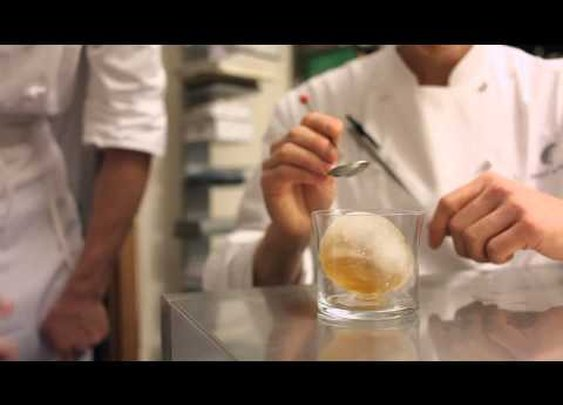 Old fashioned served in a frozen ice ball - Aviary Chicago