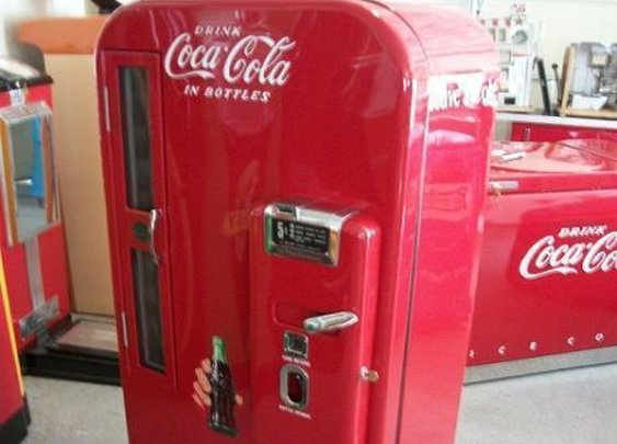 Vintage Coke Machine that Also Dispenses Beer