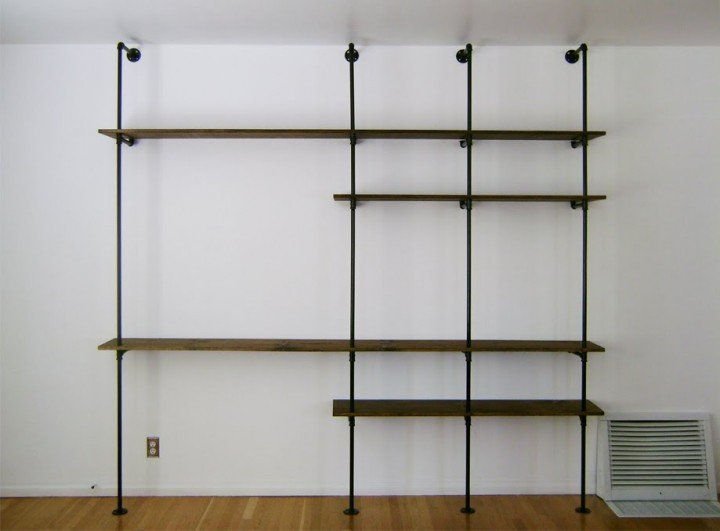 Build a shelving unit and desk out of pipes.