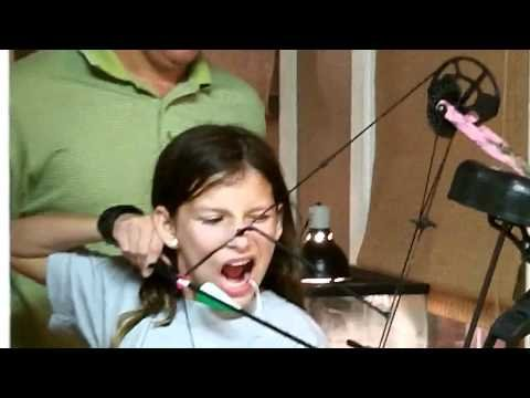 Girl shoots out loose tooth with bow and arrow