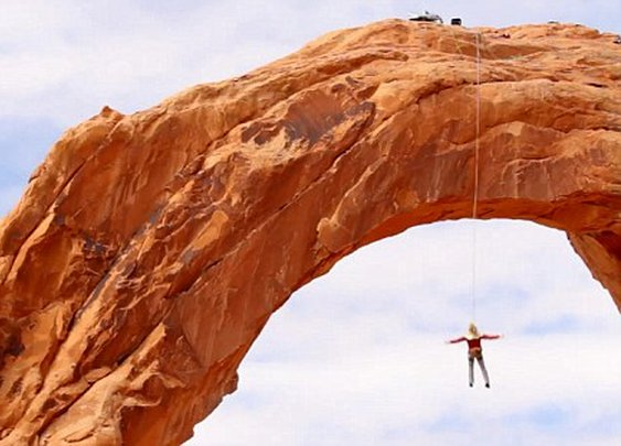 Devin Graham: Canyon believe it? Thrill-seekers take the plunge on world's largest rope swing... 150ft off a rock arch in Utah | Mail Online