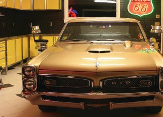 VAULT® Garage - Custom Cabinets Carriage Doors Lights Tile