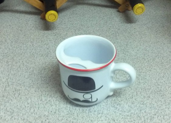 A mug that keeps your mustache dry