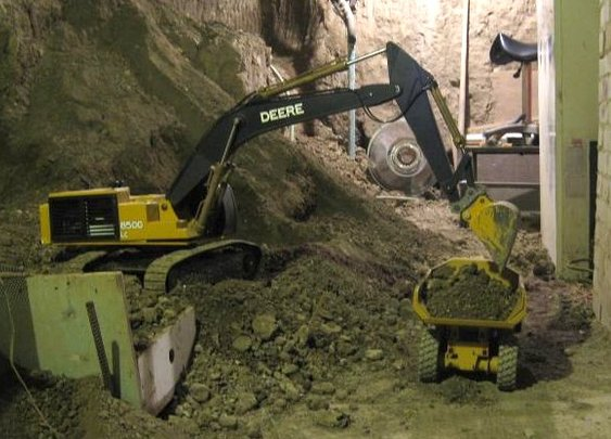 Canadian takes over seven years to dig out basement using R/C construction equipment