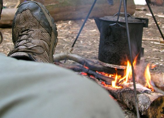 Feet up by the campfire - now *that's* camping.