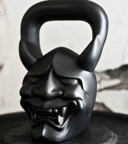 Demon faced kettle bell.