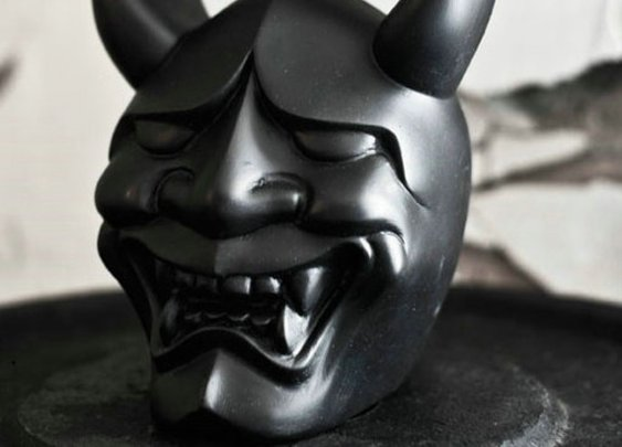 Demon faced kettle bell.