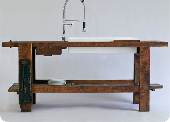An old carpenter bench, a clamp and a sink.
