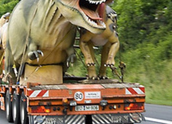 Tyrannosaurus on a truck might be the scariest thing you'll see on your commute