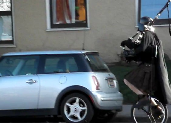 Vader on Unicycle Does Star Wars Theme on Bagpipes