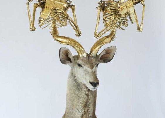Deer head skeleton machine gun.