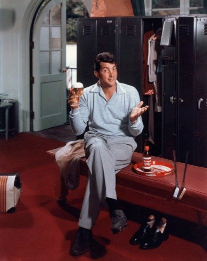 Dean Martin drinking Rheingold Beer in locker room at golf club