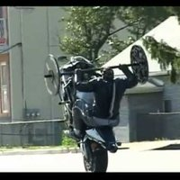 Bench Pressing While Popping a Wheelie on a Motorcycle Is Impossibly Impressive