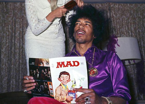Jimi Hendrix reading MAD and getting his hair did.