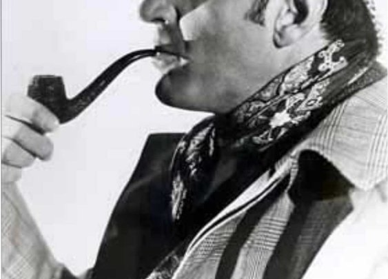 Basil Rathbone with a pipe