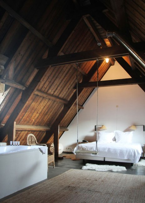 A stunning loft bedroom with swing