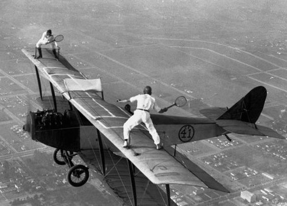 Men Playing Tennis in the Air