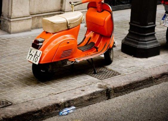 Vintage orange Vespa.