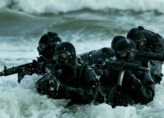 Navy Seals in the waves.