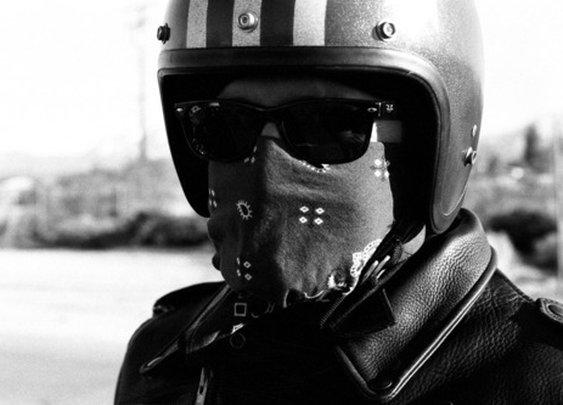 The ultimate ride setup: Helmet, wayfarers, bandana, leather jacket.