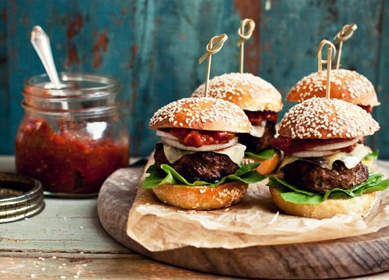 Homemade beef burgers with relish.