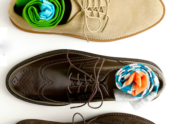A selection of brown shoes and colourful socks.
