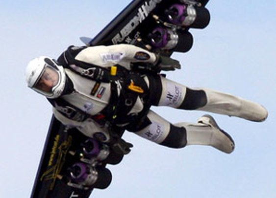 Yves Rossy is Jetman, flying with jetpack attached to his back