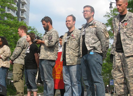 Iraq and Afghanistan veterans return medals at NATO protest.