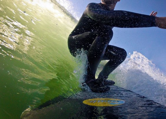 Digging a rail on Carbon Fiber Surfboard