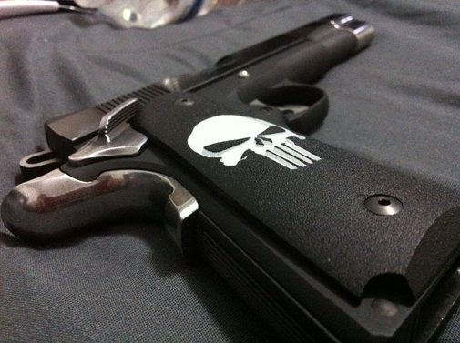 Colt .45 1911 Punisher grips (gotta get this for mine)