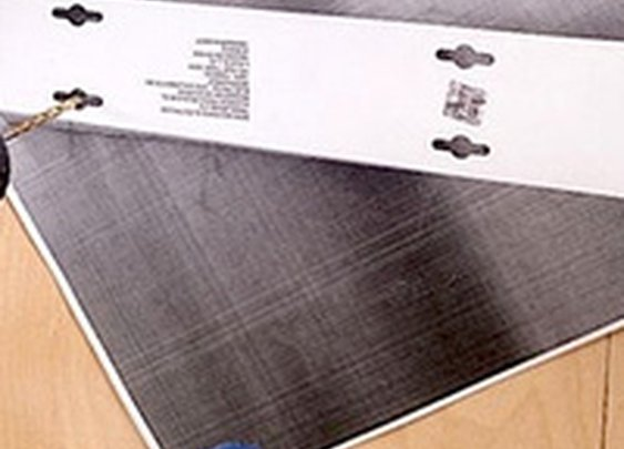 Easily Hang Tricky Items with a Photocopied Template