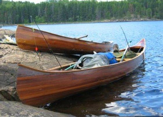Handmade wood canoes and paddles