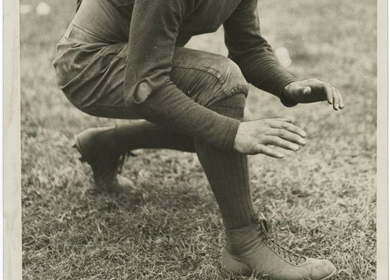 Capt. Miller, tackle for the 1928 Notre Dame Fighting Irish. Assume the stance!