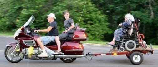 Old Lady in Wheel Chair Towed Behind Motorcylce - CollegeHumor Picture