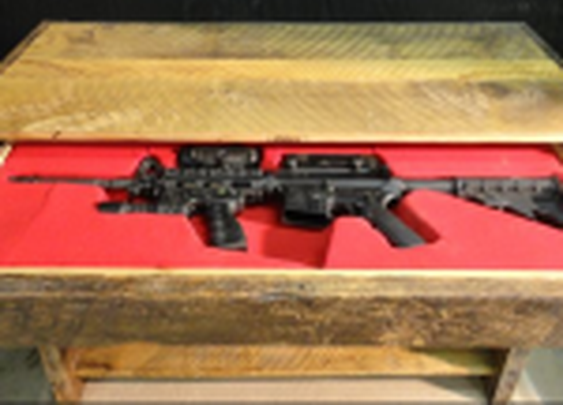 Secret drawer conceals rifle in table