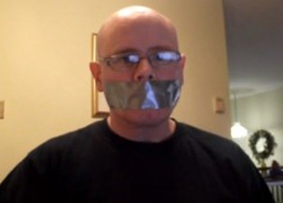 A Man Shows How Duct Taping a Person's Mouth Shut Does Not Work