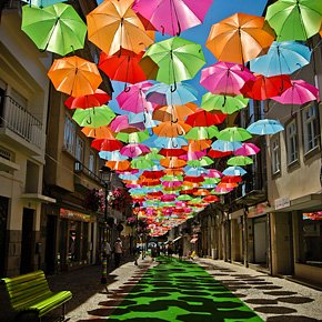 Colorful Floating Umbrellas Above a Street in Agueda, Portugal