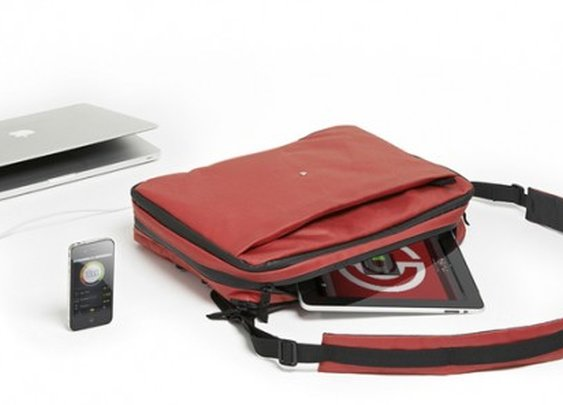 Transforming Phorce bag charges mobile devices and MacBooks