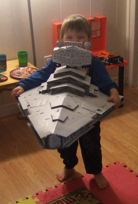 Coolest dad ever builds Star Destroyer out of cardboard, duct tape and glue.