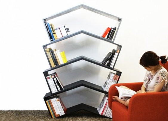 Elegant angled bookshelf needs no bookends