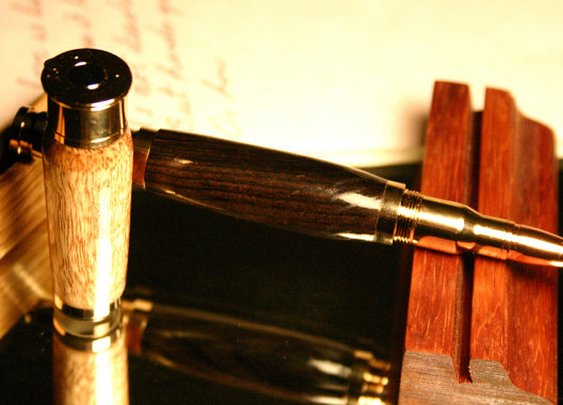 Handcrafted wood pen with shotgun and bullet by HopeAndGracePens