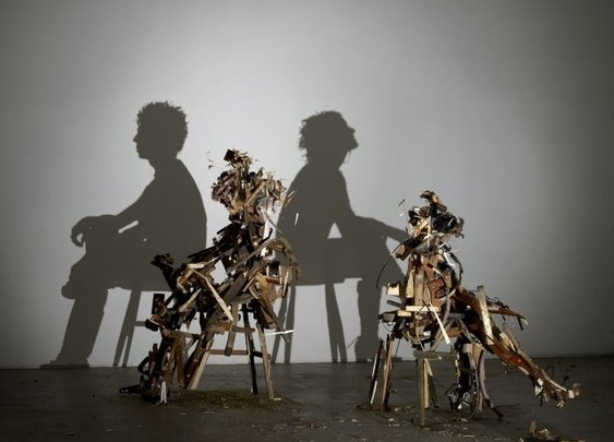 Illuminated by a projector, seemingly haphazard clumps of wood and detritus become incredibly detailed silhouettes. Photo: Tim Noble and Sue Webster