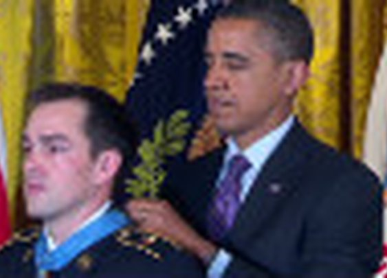 Obama honors soldier's heroics but soldier's son steals show