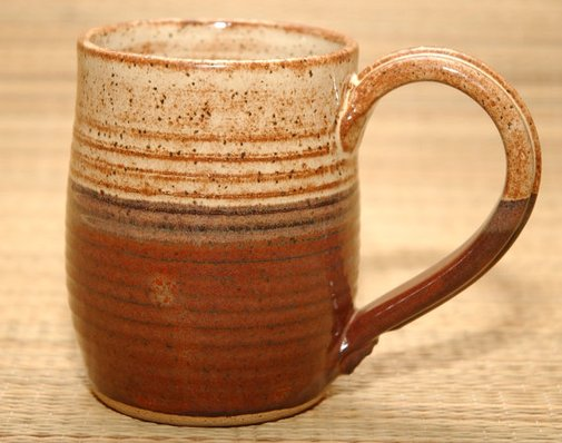 Cool handmade mug? Check.  Rustic backwoods cabin? Hmm.