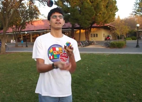 This guy solves rubiks cube while juggling it.